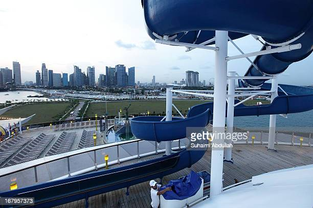 A worker is seen at the pool deck of the Costa Atlantica at the Marina Bay Cruise Centre Singapore on May 3 2013 in Singapore Costa Atlantica made...