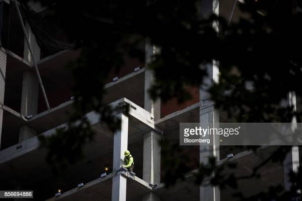 A worker is seen during construction at the 416 Kent Avenue apartment development in the Williamsburg neighborhood of the Brooklyn borough of New...