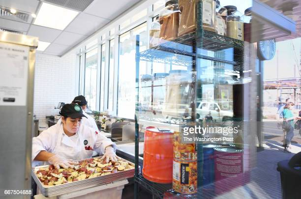A worker is seen inside the Whole Foods Market at Riverdale Park Station on Sunday April 09 2017 in Riverdale Park MD The Whole Foods Market opens to...