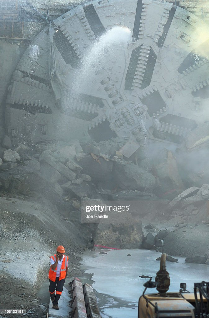 A worker is seen near the massive drill nicknamed Harriet after it broke through on Watson Island on May 6, 2013 in Miami, Florida. The emergence of the drill completed the second leg of the 13 month-old, billion dollar Miami Tunnel project, which when finished will connect the mainland to the Port of Miami.