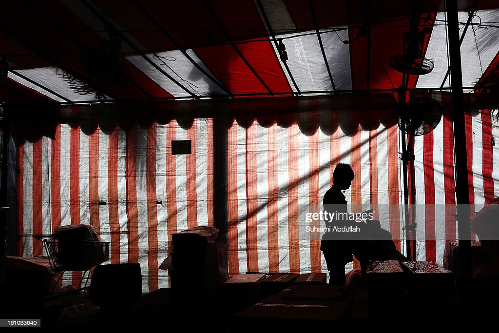A worker is seen packing his goods under a tentage, specially setup to sell Chinese New Year goodies on February 9, 2013 in Singapore. Thousands gathered today to celebrate the Chinese New Year and welcome the the Year of the Snake, with new year's day falling on February 10. Chinese new Year is the most important festival in the Chinese calendar and is celebrated in Singapore and many other Southeast Asian countries with significant Chinese Populations.