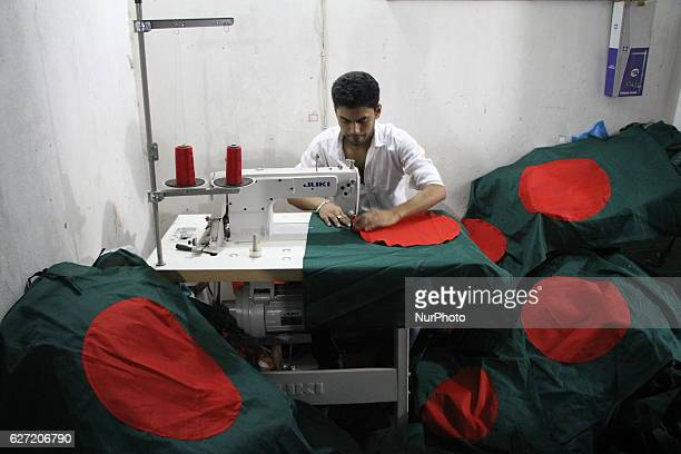 A worker is sewing the national flag of Bangladesh for upcoming event Victory Day in Dhaka Bangladesh on December 1 2016 Bangladesh won independence...