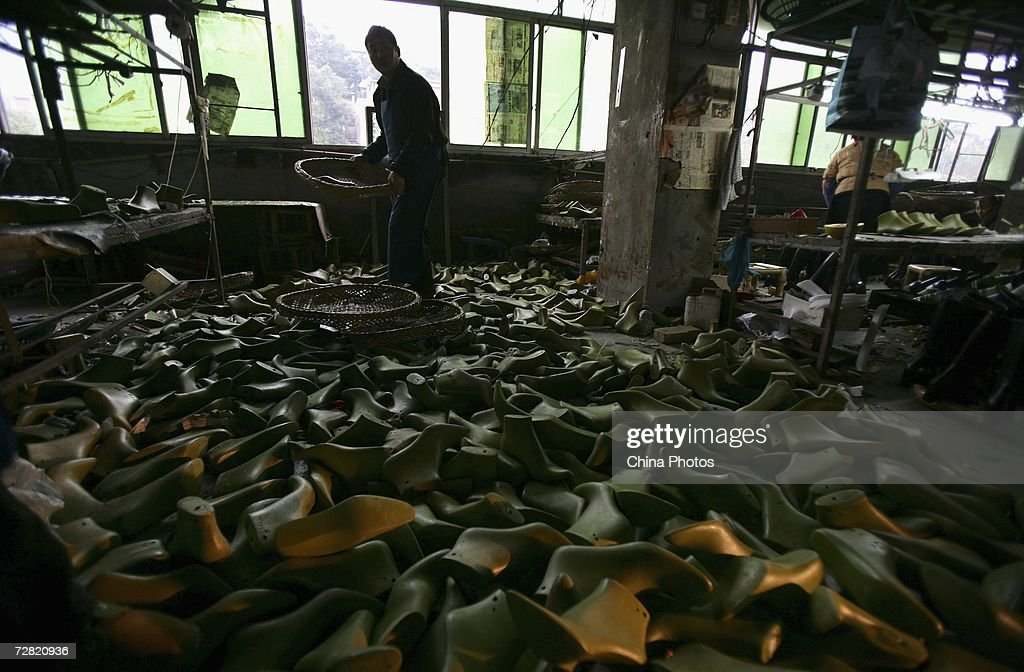 A worker labors at a shoe factory on December 12, 2006 in Chongqing Municipality, China. Chinese shoemakers plan to file a suit against the European Union (EU) contesting the legal and factual basis of the anti-dumping measures the EU has just taken against them. According to EU figures, China exported 1.25 billion pairs of shoes to Europe in 2005.