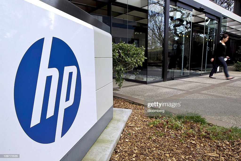 A worker leaves a building at HewlettPackard Co headquarters campus in Palo Alto California US on Monday Feb 28 2011 HewlettPackard the world's...