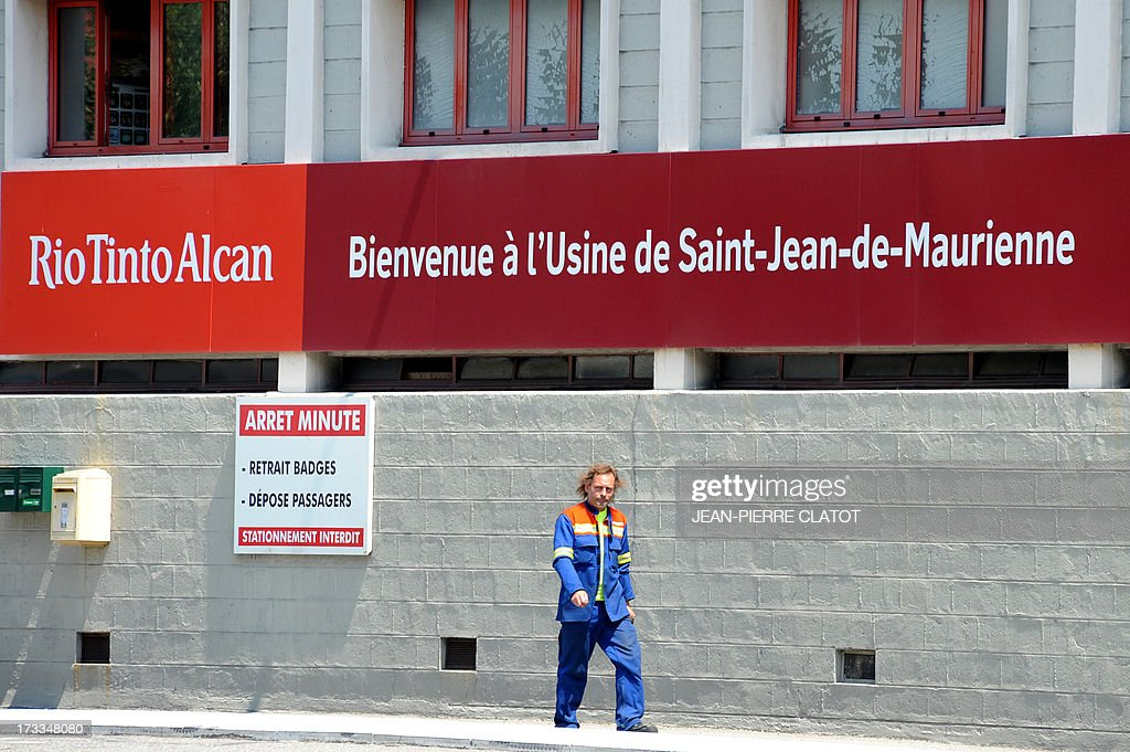 A worker leaves the Rio Tinto Alcan (RTA) aluminum factory on July 12, 2013 in Saint-Jean-de-Maurienne, southeast of France. Heads of Rio Tinto Alcan and Germany's Trimet met today in Paris regarding the take over of RTA by Trimet which could save 510 jobs at the two sites of Saint-Jean-de-Maurienne and Castelsarrasin.