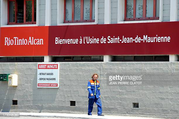 A worker leaves the Rio Tinto Alcan aluminum factory on July 12 2013 in SaintJeandeMaurienne southeast of France Heads of Rio Tinto Alcan and...