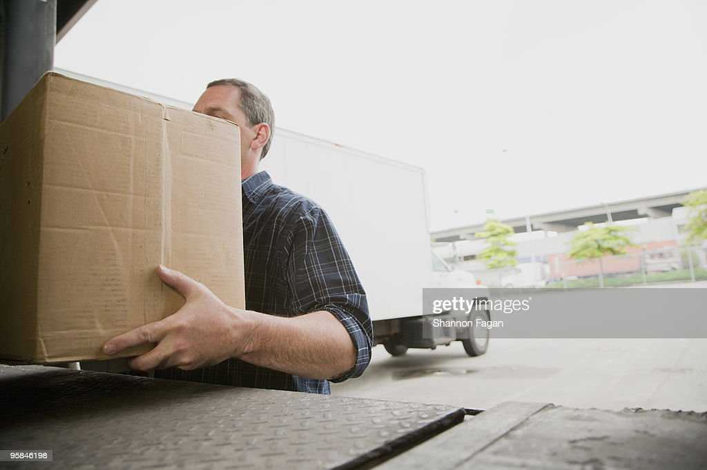 worker loading a truck at a warehouse