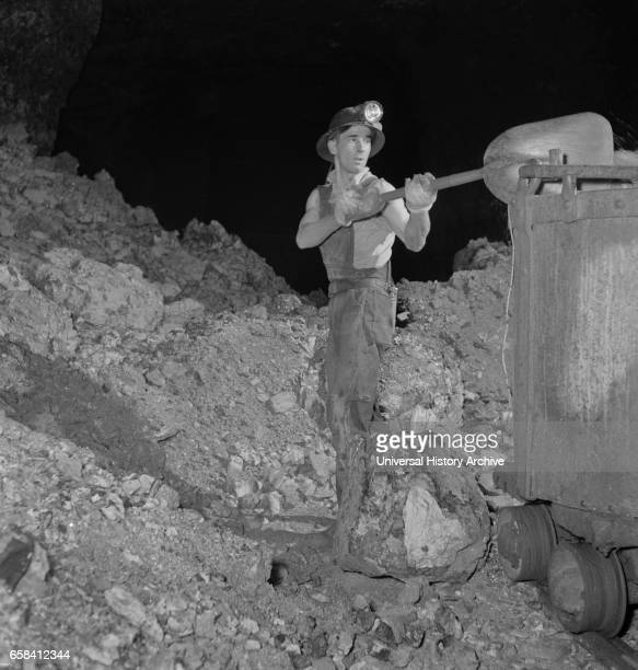 Worker Loading Zinc Ore in Mine to be used for many Purposes in the War Effort near Cardin Oklahoma USA Fritz Henle for Office of War Information...