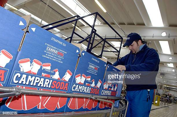 A worker loads boxes with Campari Soda on the production line at the Campari factory in Novi Ligure Italy on Tuesday April 22 2008 Davide...