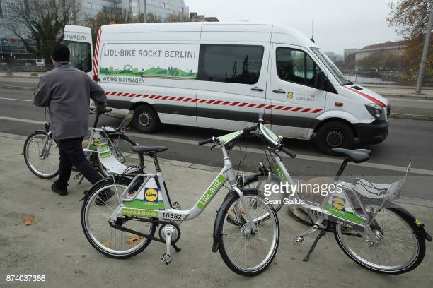A worker loads Lidl sharing bicycles into a van to redistribute them across the city in the city center on November 14 2017 in Berlin Germany A...