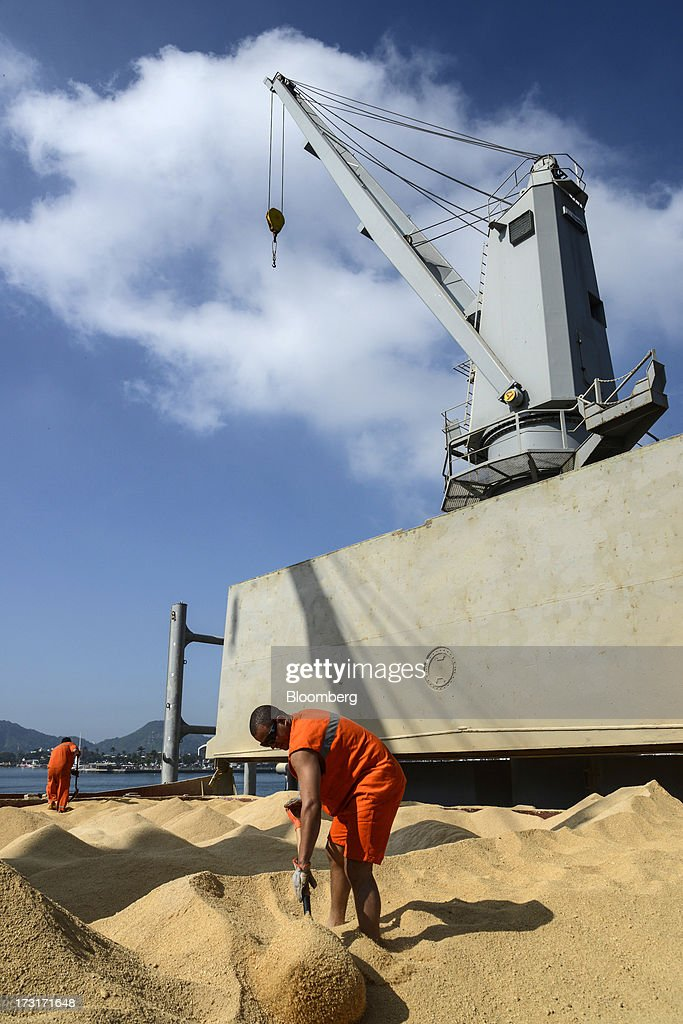 A worker loads soybean sawdust onto a ship for export at the Port of Santos in Santos, Brazil, on Friday, July 5, 2013. Rising borrowing costs and the global bond selloff triggered by the prospect of reduced U.S. stimulus are prompting Brazilian investors to boost holdings of the countrys floating-rate securities. Photographer: Paulo Fridman/Bloomberg via Getty Images