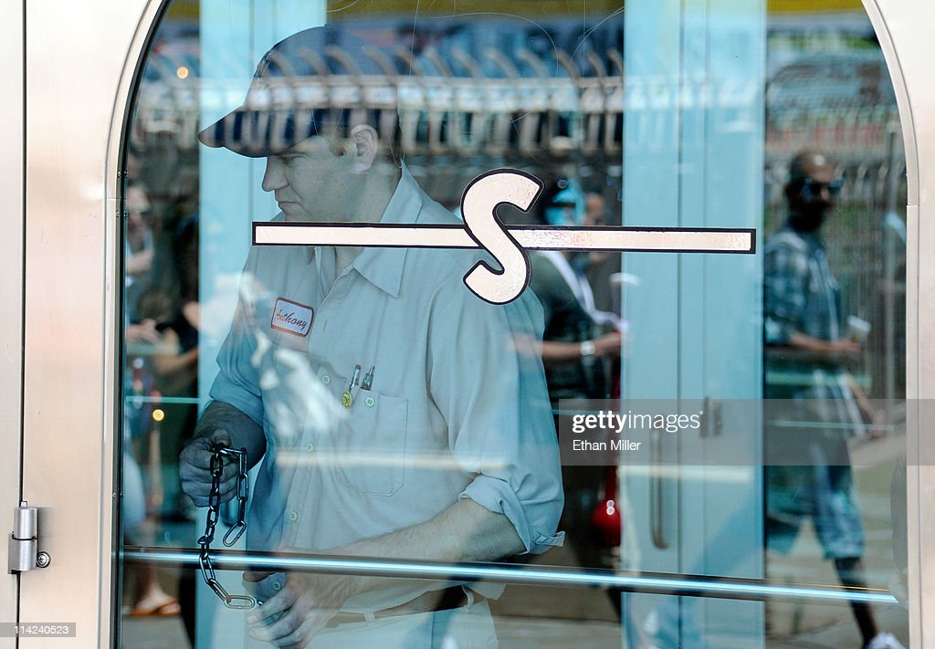 A worker locks the exterior doors at the NASCAR Cafe at the Sahara Hotel & Casino as the property is closed on May 16, 2011 in Las Vegas, Nevada. The Sahara's current owner SBE Entertainment Group closed the 1,720-room resort, which first opened in 1952, and plans to redevelop the site in the future.