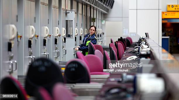 A worker looks across empty check in desks at Glasgow Airport after a limited number of flights operated this morning on April 20 2010 in Glasgow...