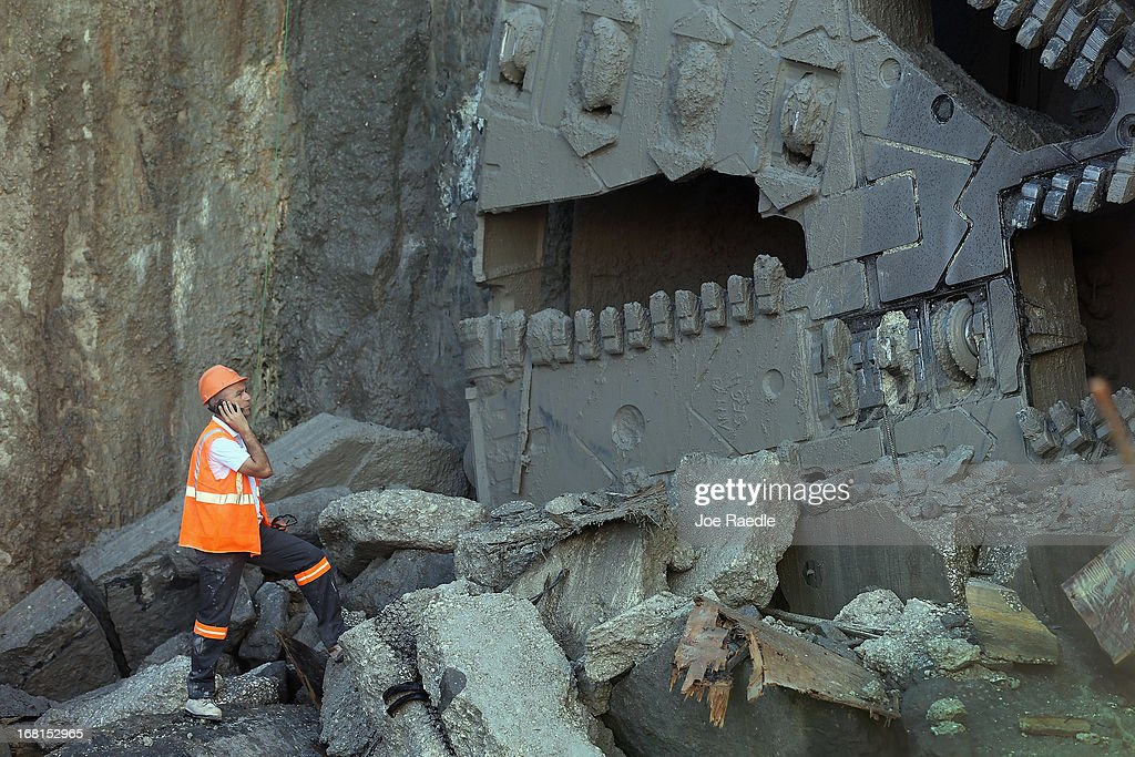 A worker looks at the massive drill nicknamed Harriet after it broke through on Watson Island on May 6, 2013 in Miami, Florida. The emergence of the drill completed the second leg of the 13 month-old, billion dollar Miami Tunnel project, which when finished will connect the mainland to the Port of Miami.