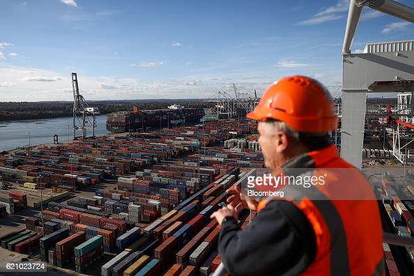 A worker looks out from a shiptoshore loading crane onto the Ludwigshafen Express container vessel operated by HapagLloyd AG as it is unloaded on the...