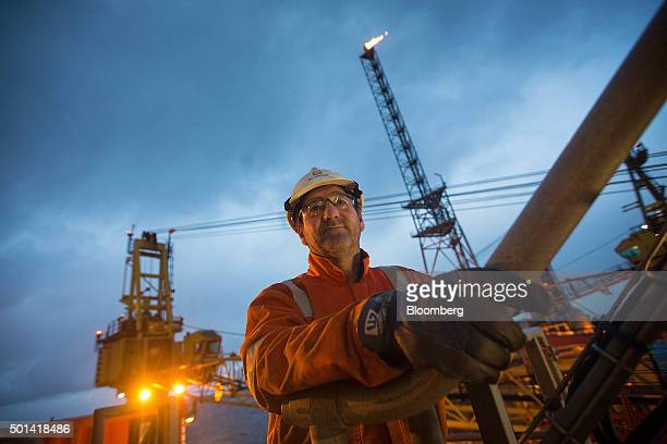 A worker looks out onto the weather deck of the Armada gas condensate platform operated by BG Group Plc in the North Sea off the coast of Aberdeen UK...