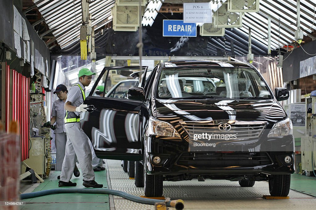 A worker makes a final check on a Toyota Motor Corp. Kijang Innova minivan on the production line of PT. Toyota Motor Manufacturing Indonesia's (TMMIN) Karawang plant in Karawang, West Java, Indonesia, on Wednesday, Sept. 14, 2011. Toyota Motor Corp., the biggest carmaker in Asia, plans to build a second factory in Indonesia at a cost of 26.3 billion yen ($341 million) to help boost sales in emerging markets. Photographer: Dimas Ardian/Bloomberg via Getty Images