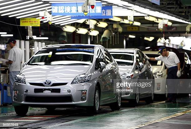 A worker makes a final inspection of Toyota Motor Corp's thirdgeneration Prius hybrid vehicles on the production line at the company's Tsutsumi plant...