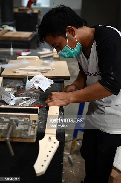 A worker makes a guitar neck at the Rick Hanes guitar factory Rick Hanes' guitars from Sidoarjo have been named as Guitar of the Year 2012 by Guitar...