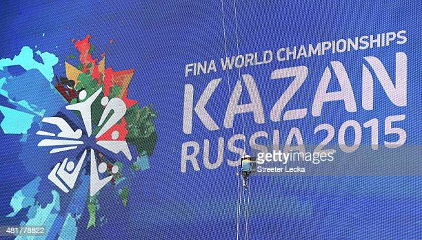 A worker makes final preparations ahead of the16th FINA World Championships on July 24 2015 in Kazan Russia