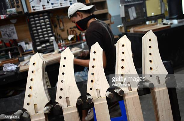 A worker makes guitar necks at the Rick Hanes guitar factory Rick Hanes' guitars from Sidoarjo have been named as Guitar of the Year 2012 by Guitar...
