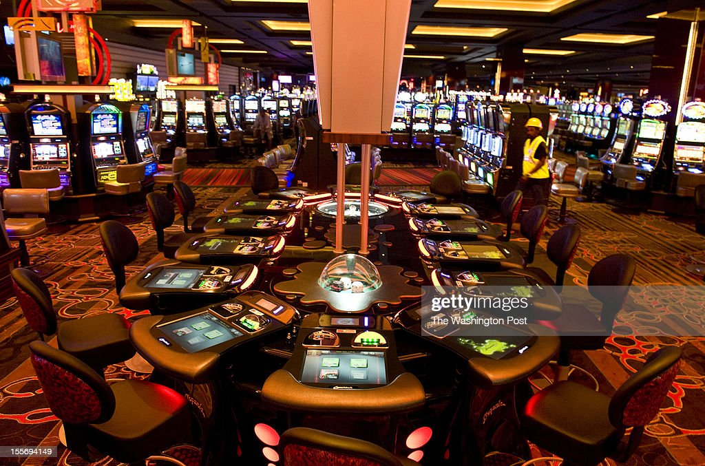 A worker makes his way through the gaming floor, 330,000-square-feet, Tuesday May 29, 2012 in Hanover, MD. Maryland Live! Casino will open at 10 pm June 6 at Arundel Mills Mall.