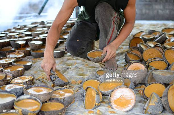 A worker making brown sugar in a small factory in Slumbung village Most Indonesian people use brown sugar to sweeten foods and beverages Brown sugar...