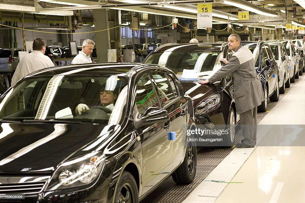 Worker making the final quality check at the Astra and Zafira assembly line at the Opel factory on January 16, 2013 in Bochum, Germany. Its Adam Opel unit will cease auto production at Bochum in 2016. The closure, initially announced in June 2012, is part of GM's efforts to resume profitability in Europe by the middle of the decade.
