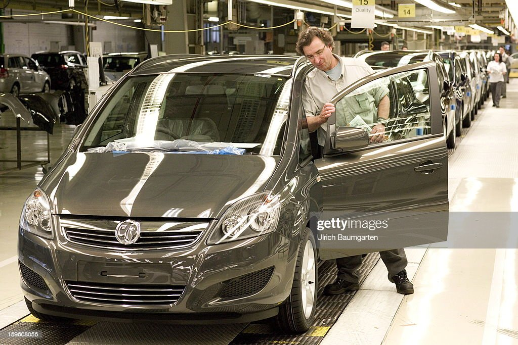 Worker making the final quality check on an Opel Astra Classic car at the Astra and Zafira assembly line at the Opel factory on January 16, 2013 in Bochum, Germany. Its Adam Opel unit will cease auto production at Bochum in 2016. The closure, initially announced in June 2012, is part of GM's efforts to resume profitability in Europe by the middle of the decade.