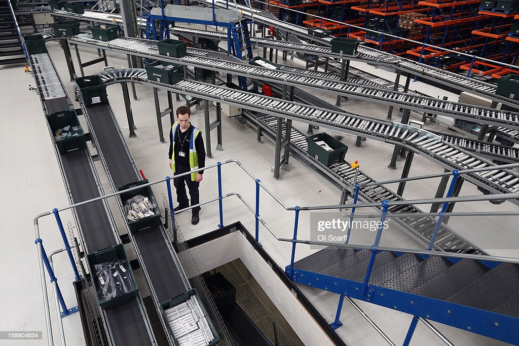 A worker manages items in an assembly line in the giant semi-automated distribution centre where the company's partners process the online orders for the John Lewis department store on January 3, 2013 in Milton Keynes, England. John Lewis has published their sales report for the five weeks prior December 29, 2012 which showed online sales had increased by 44.3 per cent over the same period in 2011. Purchases from their website Johnlewis.com now account for one quarter of all John Lewis business.