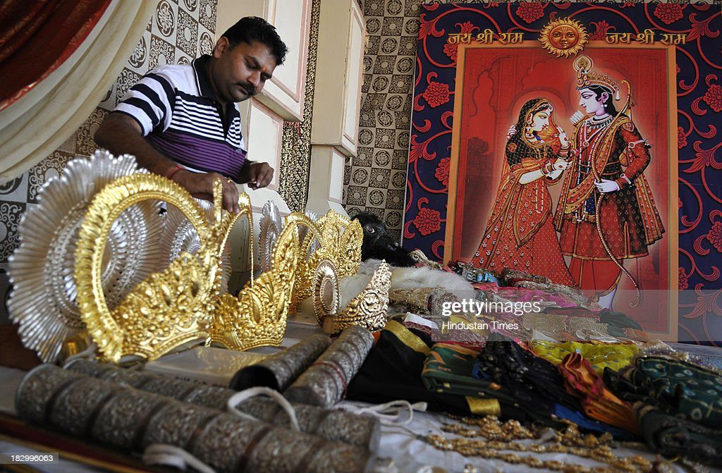 A worker managing the golden crowns which will be worn by Ram and other actors of Ramlila performance as a Ramlila preparation at Nav Shri Dharmik...