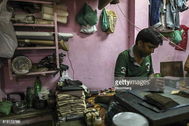A worker manufactures wallets at a leather workshop in the Dharavi area of Mumbai India on Tuesday July 18 2017 India's new goods and services tax...