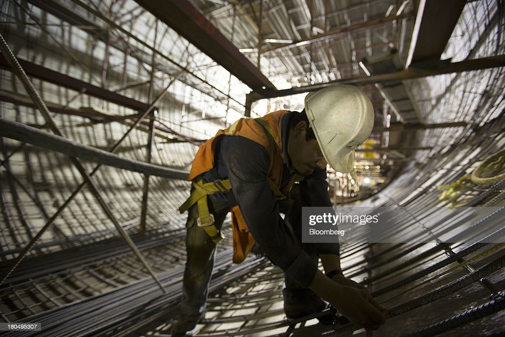 A worker marks a steel rod inside the Tunnel Emisor Oriente (TEO), or Eastern Discharge Tunnel, during construction of the 38 mile (62km) underground wastewater treatment tunnel in Mexico City, Mexico, on Thursday, Sept. 12, 2013. The tunnel, which is expected to be completed in 2014, will boost Mexico City's drainage capacity to help prevent flooding during rainy season and the over-exploitation of groundwater resources. The project is being managed by Mexico's National Water Commission, Conagua. Photographer: Susana Gonzalez/Bloomberg via Getty Images