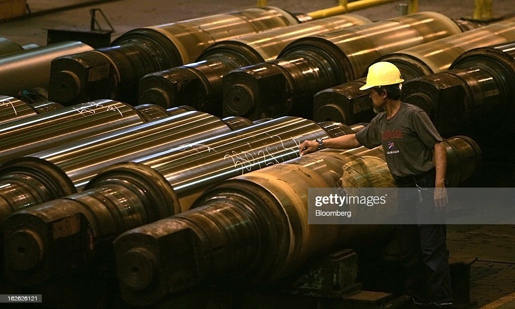 A worker marks steel rollers in the roll shop area of the PT Krakatau Steel plant in Cilegon, Banten province, Indonesia, on Thursday, Feb. 21, 2013. Krakatau Steel is Indonesia's biggest maker of the metal. Photographer: Dadang Tri/Bloomberg via Getty Images