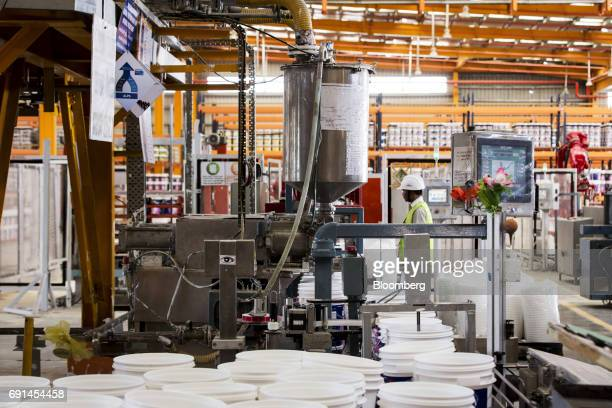 A worker monitors a filling line at an Akzo Nobel India Ltd paint factory in Gwalior Madhya Pradesh India on Thursday June 1 2017 Akzo Nobel NV...