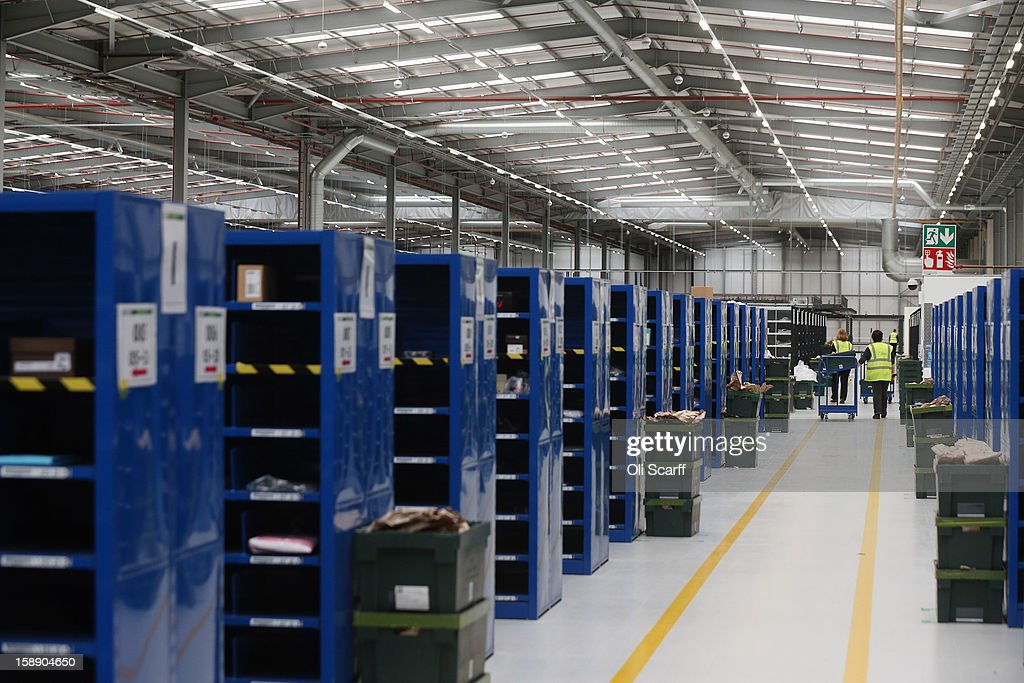A worker moves a cart in the giant semi-automated distribution centre where the company's partners process the online orders for the John Lewis department store on January 3, 2013 in Milton Keynes, England. John Lewis has published their sales report for the five weeks prior December 29, 2012 which showed online sales had increased by 44.3 per cent over the same period in 2011. Purchases from their website Johnlewis.com now account for one quarter of all John Lewis business.