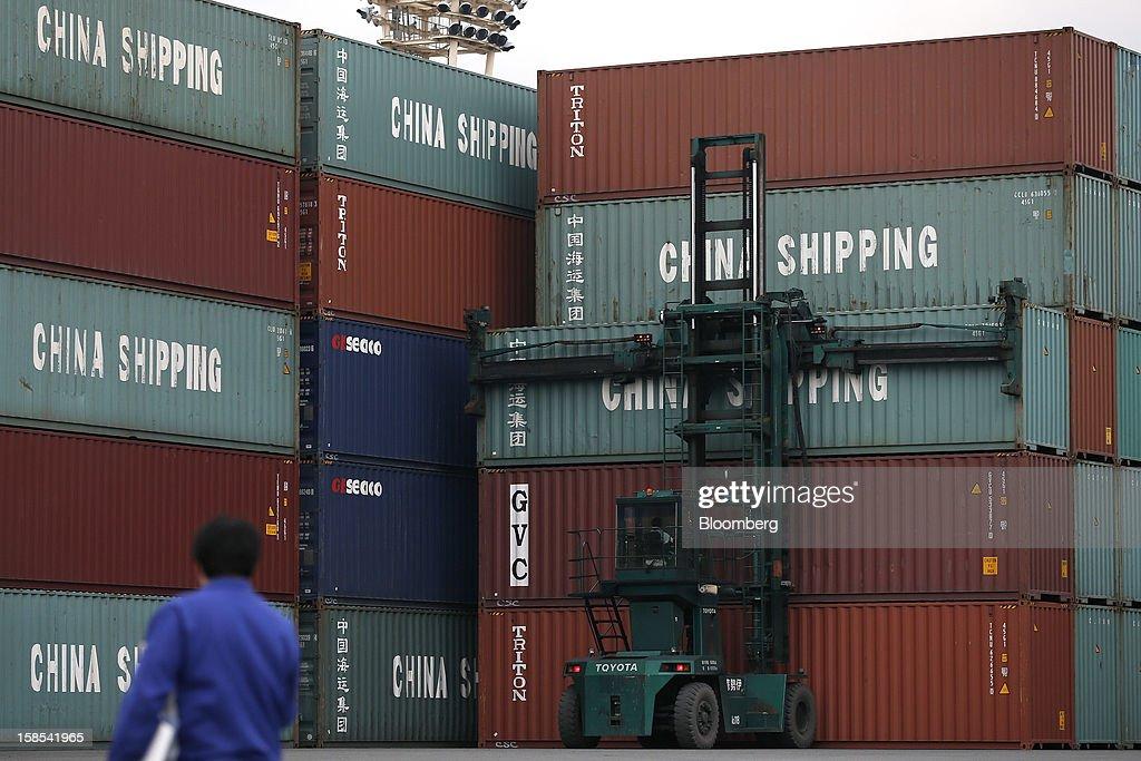 A worker moves a China Shipping Container Lines Co. container with a forklift at a container terminal in Tokyo, Japan, on Tuesday, Dec. 18, 2012. Japan's exports fell for a sixth month in November and the trade deficit swelled, underscoring the challenge that incoming Prime Minister Shinzo Abe faces in reviving growth. Photographer: Kiyoshi Ota/Bloomberg via Getty Images