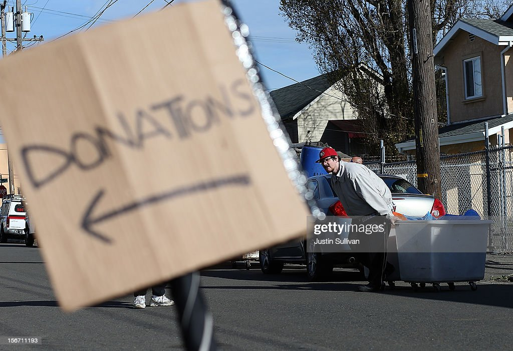 A worker moves a donation bin at the Bay Area Rescue Mission on November 19, 2012 in Richmond, California. Days ahead of Thanksgiving, the Bay Area Rescue Mission received a donation of 320 turkeys and 60 hams from local business Bay Alarm that will be used to feed a holiday meal to needy and underpriviledged people.