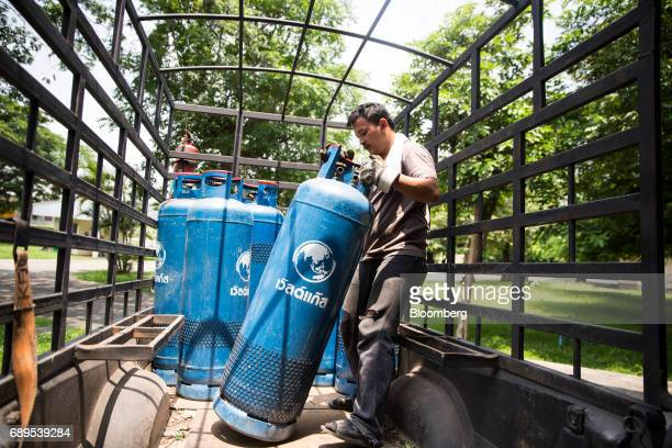 A worker moves a gas canisters on a truck outside the Nithi Foods Co factory in the San Pa Tong district of Chiang Mai Thailand on Tuesday May 23...