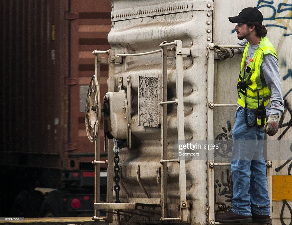 A worker moves a refrigerated railcar along the tracks at the Union Pacific Intermodal Terminal in Oakland, California U.S., on Wednesday, Jan. 23, 2013. Union Pacific Corp., the largest U.S. railroad by sales, posted higher fourth-quarter earnings than analysts estimated as shipments of chemicals and automobiles climbed. Photographer: Ken James/Bloomberg via Getty Images