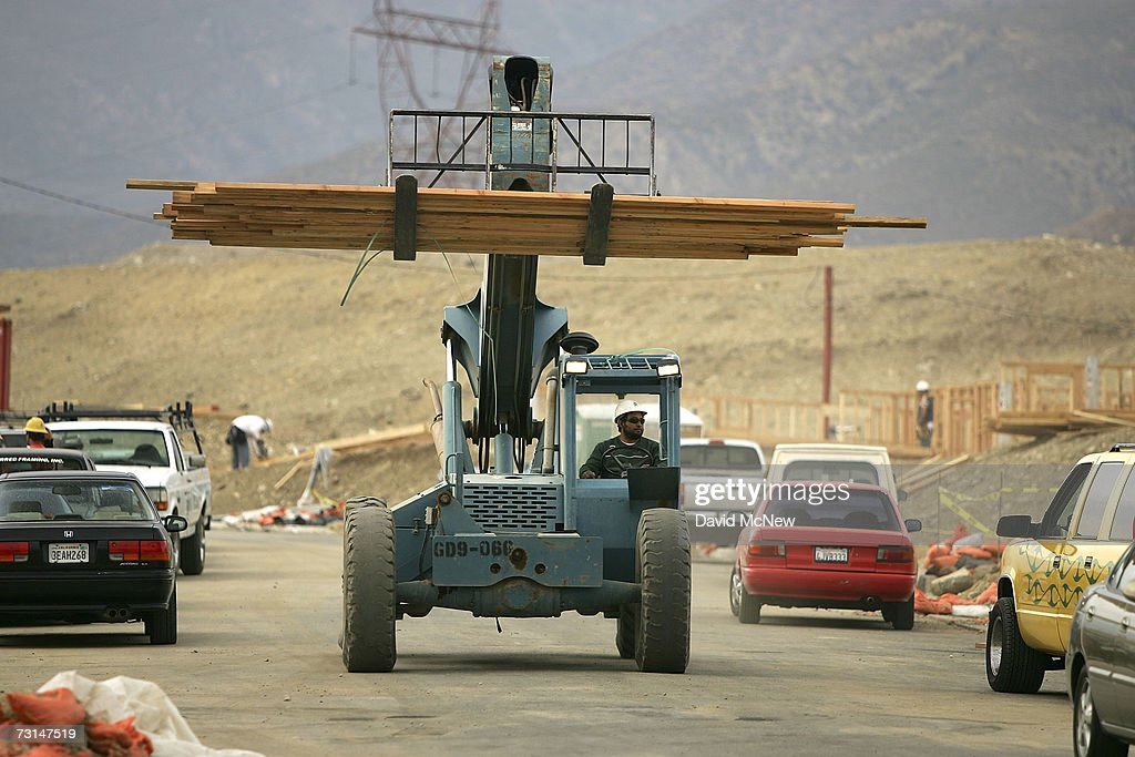 A worker moves lumber at a construction site for surburban homes January 29, 2007 in Rancho Cucamonga, California. The U.S. Commerce Department reported sales of new homes in December rose by 4.8 percent, following an even stronger 7.4 percent increase in November. But that wasn't enough to erase a loss of 17.3 percent for 2006 from 2005, which marked the biggest decline since 1990.
