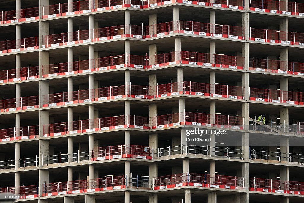 A worker moves materials around on a construction site in the City of London on October 30, 2012 in London, England.