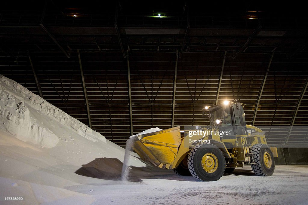 A worker moves urea fertilizer at Growmark Inc.'s Bussen Terminal along the Mississippi River in St. Louis, Missouri, U.S., on Friday, Nov. 30, 2012. The rush is on to keep customers supplied, workers employed and commerce alive in communities that rely on the nation's busiest waterway. The usual dry season, combined with the worst drought in 50 years, may push water levels so low in coming weeks it will halt traffic in a section south of St. Louis, near the river's midpoint. Photographer: Whitney Curtis/Bloomberg via Getty Images
