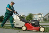 A worker mows strips of grass in front of the Chancellery with a lawn mower on June 15 2011 in Berlin Germany Germany is currently enjoying summer...