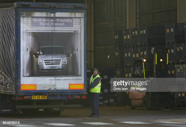 A worker next to a truck advertising the Ford Transit at the Ford factory in Southampton where workers have started a fourday week as the company...