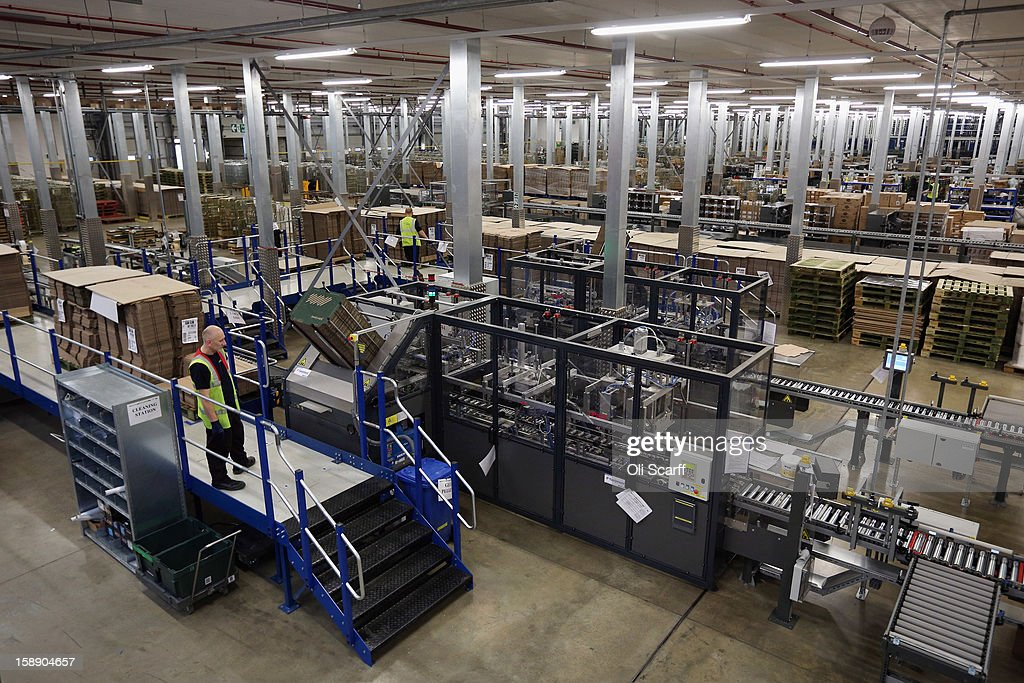 A worker observes the giant semi-automated distribution centre where the company's partners process the online orders for the John Lewis department store on January 3, 2013 in Milton Keynes, England. John Lewis has published their sales report for the five weeks prior December 29, 2012 which showed online sales had increased by 44.3 per cent over the same period in 2011. Purchases from their website Johnlewis.com now account for one quarter of all John Lewis business.