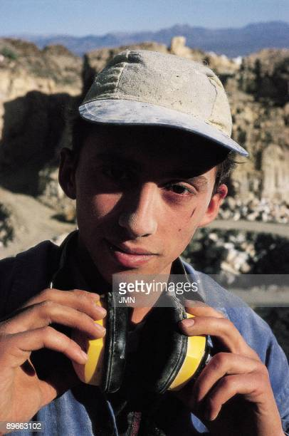 Worker of a marble quarry Posed of a worker of a marble quarry that takes some protective headphones for the noise