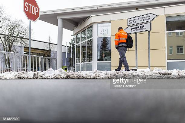 A worker of Bombardier walks to the plant on January 09 2017 in Bautzen Germany According to media reports Canadian train manufacturer Bombardier...