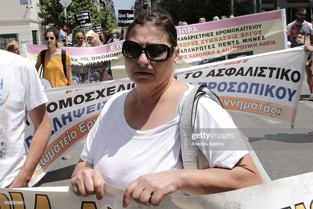 A worker of Greece State Hospital Federation holds a banner during protest against the social security law at Ministry of Health in Athens, Greece on June 29, 2016.