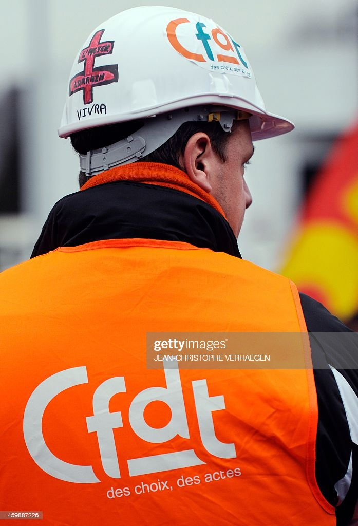 A worker of the ArcelorMittal steel company blocks access to the factory in Florange eastern France as he demonstrates to denounce the closing of the...